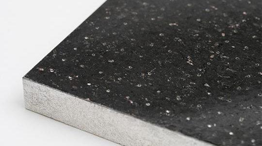 Black Galaxy Steinfurnier auf geblähtem Glas-Recycling-Granulat, Steinoberfläche matt geschliffen und perforiert